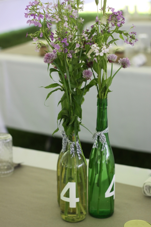 wine bottle wedding centerpieces | Tuxedo & Russell's Hudson Valley June Wedding | Brooklyn Homemaker