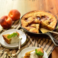 caramelized peach cornmeal skillet cake with bourbon whipped cream