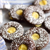 spicy gingerbread linzer cookies with orange white chocolate ganache