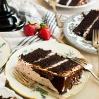chocolate tuxedo cake with strawberry mascarpone icing